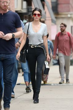 The model dresses down in a simple grey t-shirt and high-waisted skinny jeans while out in NYC.   - HarpersBAZAAR.com