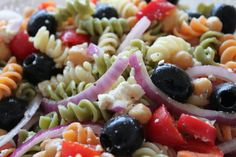 GREEK PASTA SALAD 1/2 c. favorite Italian dressing 1/3 c. finely chopped onion 1/4 tsp. salt 1/8 tsp. pepper 6 oz. Muellers Ruffle Trio Pasta, cooked & rinsed with cold water 1 c. chopped, seeded cucumber 1/2 c. pitted ripe olives, halved 1/2 c. crumbled feta cheese 1 tbsp. lemon juice In large bowl stir dressing and all other ingredients except pasta and cheese. Once stirred together add pasta and stir again. Then add cheese and stir again.