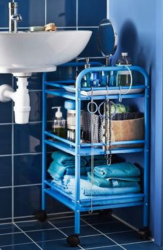 Use a freestanding DRAGGAN cart to save space in the bathroom! Its size and wheels makes it easy to move around to fit almost anywhere you need it. Extra tip: Add S-hooks to the rails to hang towels and jewelry from.