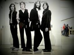 This life size picture in front of Apple store. Read more about the Beatles here at beatlesfansunite.com. Join for free and vote for your favorite Beatles.