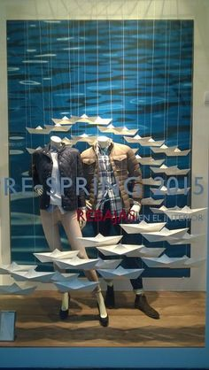 Original shop window display from thommy hilfiger with origami paper boats: