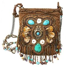 Meditate on the thought of perfection with Zen. A fabulously embellished real leather cross-body bag highlighted by turquoises and glamorous beadwork and rhinestones adds that perfect flare to any outfit. Detach the removable strap and wear it as a necklace.