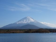 The mountain - by rdwolf A picture of Mt. Fuji from lake Shoji by my new camera. I was lucky to see the mountain in a calm day.  Photo information:      Camera: SONY DSC-RX100      Date and Time: 2014:11:23 13:33:17      Aperture: f/5.6      ISO Speed: 125      Focal length: 22.01 mm      Flash: Flash did not fire, compulsory flash mode      Exposure: 1/800 (0.001 sec)      Exposure Program: Landscape mode      Metering Mode: Pattern