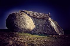 Stone house sandwiched between two rocks in the Fafe Mountains, Portugal
