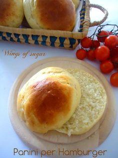 Panini per Hamburger fatti in casa 450g di farina 00 30g di zucchero 1 uovo 30g di burro morbido 15g di lievito di birra (cubetto) 1 e 1/2 cucchiaino di sale 1 e 1/2 bicchiere di acqua tiepida