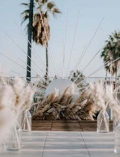 You've Got to See this Modern Meets Vintage Monochrome White Wedding in Hollywood - Green Wedding Shoes Wooden starburst ceremony decor with pampas grass. Wedding Trends, Boho Wedding, Wedding Styles, Wedding Ceremony, Wedding Flowers, Wedding Day, Wedding White, Wedding Peach, Wedding Arches