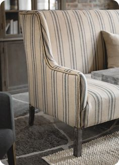 Loving the combination of nailhead trim and the striped fabric.