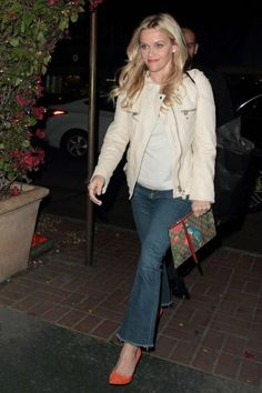 Reese Witherspoon looked stylish and gorgeous as she opted to go for a casual chic ensemble comprising of jeans and leather jacket, while stepping inside Madeo restaurant to grab a bite to eat on Monday evening (March 28, 2016) in West Hollywood, California. For her dinner outing, she was joined by her close pal and pop sensation Taylor Swift. Earlier this month, Swift had given a special performance at Reese's star-studded birthday party at Warwick in Hollywood.