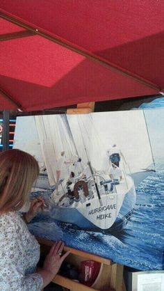 """Darcy Gerdes continues work on """"Hurricane Heike,"""" a work in progress, on The Spruce Moose deck.  Photo by Jay Pentrack"""