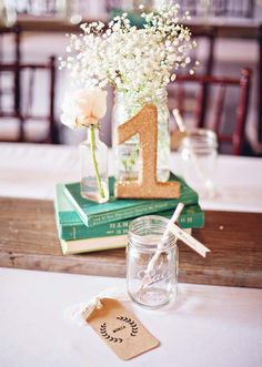 Colorful and inter sting to look at centerpiece with table numbers.