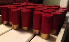 Shotgun Shell decorations for my son's Hunting/Camo theme 7th birthday party!  Just toilet paper rolls and duck tape. I plan on stringing some together to make a few garlands and using the rest as table decorations.