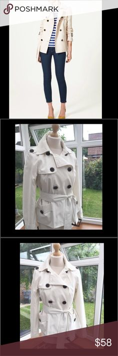 """Zara Trench Coat Super cute hip length Zara double breasted trench coat. Slit side pockets with button closure. All buttons have Zara written on them. Belted. 25"""" from shoulder to hem. Zara Jackets & Coats Trench Coats"""