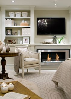 UPSTAIRS SITTING ROOM: Eco-friendly, ethanol fireplace with built-in storage