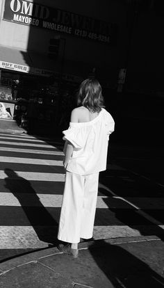 "For a twist on the classic white shirt, Lucy Hutchings (Vogue.co.uk editor) recommends trying the new season's off-the-shoulder trend. ""It's fashion's new erogenous zone."""