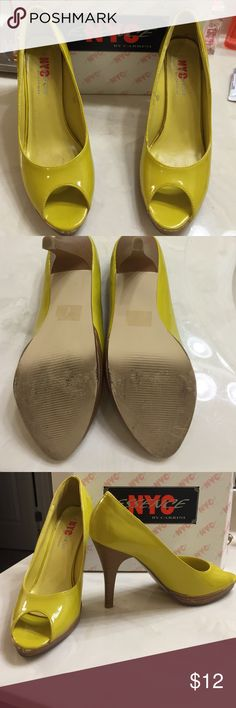 """Patent dark yellow 4"""" platform heels used NYC essence by Carrini brand used dark yellow patent slight platform 4"""" open toe heels. Right shoe has some minor scuffing at tip of toe and scuffing at bottom base of left side of platform as pictured. Left shoe has minor scuffing on right side of bottom of platform as pictured and small scuff at top right side of shoe. Insoles also has some minor wear. Size 6.5. NYC essence  Shoes Heels"""
