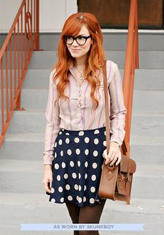 An off-day from work and an empty to-do list makes for your favorite kind of Saturday schedule - one filled with opportunity to meander the city in your most carefree, navy skirt. Polka-dotted with charming taupe circles, this lined, silky-smooth, zip-up skirt is as effortless to wear as it is to style.