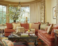 Living room with terracotta colored sofa and cream walls -- Andrew Skurman Architects, skurman.com