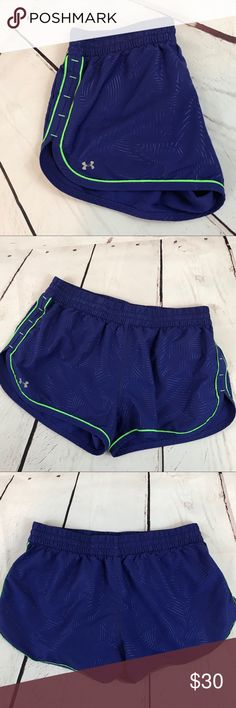 "Under Armour Heat Gear Semi Fitted Shorts Ladies Under Armour Semi Fitted Athletic Shorts.   Heat gear (to help you stay cool!).  Purple pattern with gray lining and neon green trim/strings.  EUC.   Very gently used.  Measurements are approximate, from flat lay, not doubled, and not stretched:   Waist- 15"" and Length- 11.5"". Under Armour Shorts"