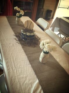 Baby Kruz!! Our beautiful vintage baseball theme tables. Hand craft mason jars & diaper cakes!