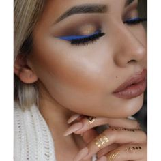 I love everything, maybe a bit less bronzer. love the mauve/ bare lip color, gold eye shadow with a splash of blue liquid eye liner....Also the temporary gold tattoos on her hand!