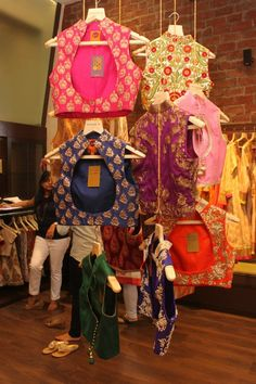 Cocktail blouses made of banaras cloth with high neck embossed with heavy embroidery zari work