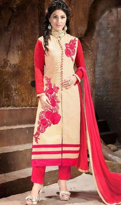 Precise splendor comes out of your dressing trend with this cream and fuchsia color chanderi silk pant style suit. You could see some interesting patterns accomplished with lace and resham work. #pantstyledresses #standcollaredstraightdress #straightembroideredsuit