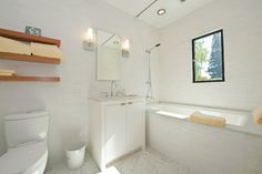 wood  modern bathroom by Mueller Nicholls Cabinets and Construction