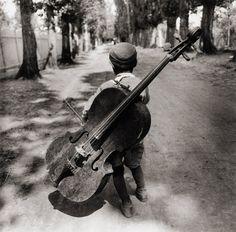 Eva Besnyö Untitled [boy with a violoncello, Balaton, Hungary] 1931