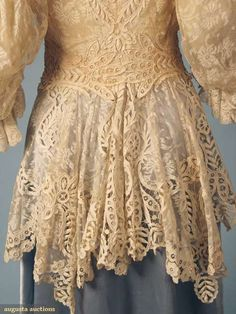 "CREAM LACE JACKET, c. 1905 Valenceinnes lace, puffed & flounced elbow length sleeve, bodice fitted to waist w/ long peplum, embroidered eyelet trim on peplum, collar & jacket back, blush lining, B 36"", W 25"", (lining shattered) excellent. BMCC Augusta Auctions"