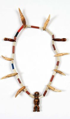 DR Congo | Necklace worn by a member of the Bwami society of the Lega people | Glass beads, teeth, ivory amulet | Est. 800 - 1000  € ~ (Sept '14)