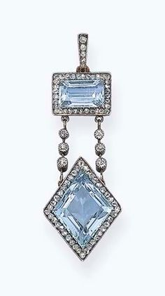 A BELLE EPOQUE AQUAMARINE AND DIAMOND PENDANT, BY FABERGÉ   The lozenge-shaped aquamarine within a rose-cut diamond surround suspended by two knife-edge and old-cut diamond spacers from a rectangular-shaped aquamarine within a rose-cut diamond surround, mounted in platinum and gold, circa 1900, 4.5 cm long, with Russian assay mark for gold, in fitted beige wooden Fabergé case  With workmaster's mark of August Frederik Hollming for Fabergé #Faberge #AntiqueJewelry