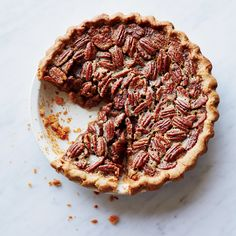 This easy pecan pie tastes of dark caramel, toasted nuts and a little bit of bourbon—not just sweetness. The press-in crust means you don't even need a rolling pin.