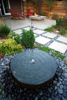 Millstone fountain. modern landscape by Mile High Landscaping