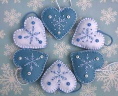 Felt Christmas heart ornaments, Handmade blue and white snowflake hearts, Scandinavian embroidered heart decorations, felt tree ornaments Felt Christmas heart ornamentsHandmade blue and by PuffinPatchwork Felt Christmas Decorations, Felt Christmas Ornaments, Handmade Ornaments, Handmade Christmas, Christmas Diy, Snowflake Ornaments, Tree Decorations, Snowflakes, Christmas Projects
