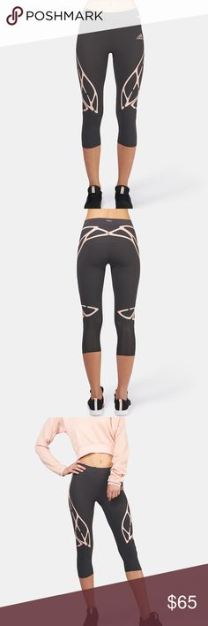 ADIZERO SPRINTWEB 3/4 CAPRI LEGGINGS NO TRADES - SO DIFFERENT. LOVE THESE. COLOR IS DARK GRAY AND LIGHT PINK. These women's running leggings offer a convenient three-quarter length, stretchy comfort and total mobility for high-intensity workouts. A compre