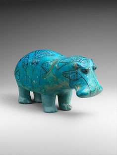 Hippopotamus Period: Middle Kingdom Dynasty: Dynasty 12, first half Reign: Senwosret I to Senwosret II Date: ca. 1961–1878 B.C. Geography: From Egypt, Middle Egypt, Meir (Mir), Tomb B no. 3 of the nomarch Senbi II, pit 1 (steward Senbi), Khashaba 1910 Medium: Faience Dimensions: L. 20 cm (7 7/8 in.); W. 7.5 cm (2 15/16 in.); H. 11.2 cm (4 7/16 in.) Credit Line: Gift of Edward S. Harkness, 1917 Accession Number: 17.9.1 This artwork is currently on display in Gallery 111