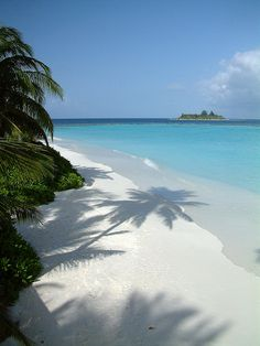White sand, blue sea at Vakarufalhi Dhoni Jetty, Maldives, Indian Ocean.