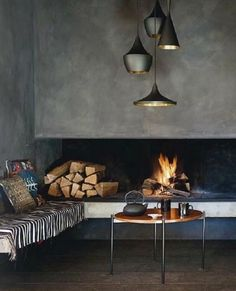 Modern Concrete Fireplace by Tom Dixon, lights... love them