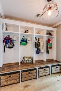 Rustic Mud Room With Standard Height, Built In Bookshelf, Crown Molding,  Hardwood Floors, Pendant Light