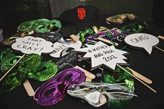 Beads and masks to complete this Mardi Gras inspired wedding! // Photo by : http://megphoto.com
