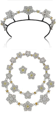 AN IMPRESSIVE SUITE OF DIAMOND AND COLOURED DIAMOND JEWELLERY. The front of the necklace designed as a detachable swag composed of five graduated diamond flowerheads, three flowerheads mounted with a yellow diamond, surrounded by a diamond cluster centre to the diamond petals,  interspersed by connecting links of pear-shaped diamonds and diamonds of foliate motif, converts to form a tiara; with ear clips en suite, with diamond-set leather fitted cases