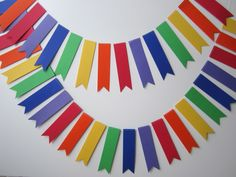 Rainbow paper garland.  You can buy them ready made or have a go at making them yourself.  Think bridesmaids, wine and garland making party.  --- $15.00, via Etsy.