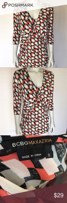 • BCBGMaxAzria • colorful patterned blouse Gorgeous multicolored top with geometric pattern. Black, gray, white, and coral colored shirt. Gathers in the front for a flattering look. Soft, stretchy, and so comfortable. Beautiful shirt for professional work settings. BCBGMaxAzria Tops Blouses
