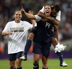 USA's Abby Wambach (14) and Shannon Boxx (7) celebrate after defeating Japan in at Wembley Stadium in a gold medal soccer match during the London 2012 Olympics on Thursday, August 9, 2012 in London. USA defeated Japan 2-1 to win gold for the third Olympics in a row.