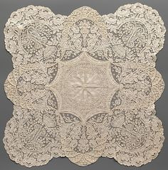 Handkerchief, ca, 1865, Belgian, cotton, bobbin lace  While most lace handkerchiefs consist of a woven fabric with a wide lace border, this example is made entirely of bobbin lace, a specialty of the Convent of Notre Dame de Visitation in Ghent. In 1852 Sister Marie-Joseph patented a new style of lace, now called Ghent Lace with Varied Ground, making it possible to employ workers of varying skill levels and to assemble large pieces quickly using motifs that could be prepared ahead of time.