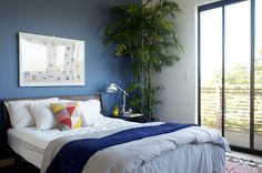 Bedroom accent wall | Blue - Color scheme | A Modern Elysian Heights Home for Two Creatives | Design*Sponge
