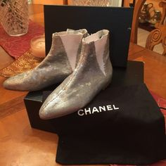 Chanel silver short booties New authentic gorgeous short booties, silver sequence , with metal CC logo on the sides, no box just a dust bag!please email Irina.spotar@yahoo.com for a price questions CHANEL Shoes