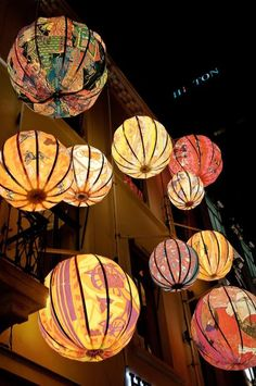 Hermes paper lanterns.. beautiful.. subtle colours on the marquee roof to offset the simple neutral colours table settings?