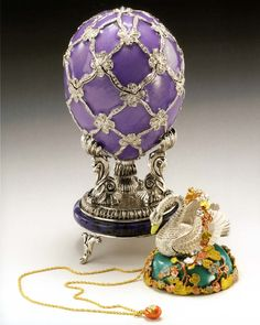 Swan Egg, 1906. Presented by Nicholas II to Dowager Empress Maria Fyodorovna. Egg: gold, rose-cut diamonds, portrait diamonds - Swan: quatre-couleur gold, silver-plated gold, aquamarine. Kept in Edouard & Maurice Sandoz Foundation, Lausanne, Switzerland.