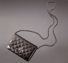 Black CHANEL lambskin wallet on a chain. So versatile, you can wear it so many ways (short, long, cross-body, clutch...)